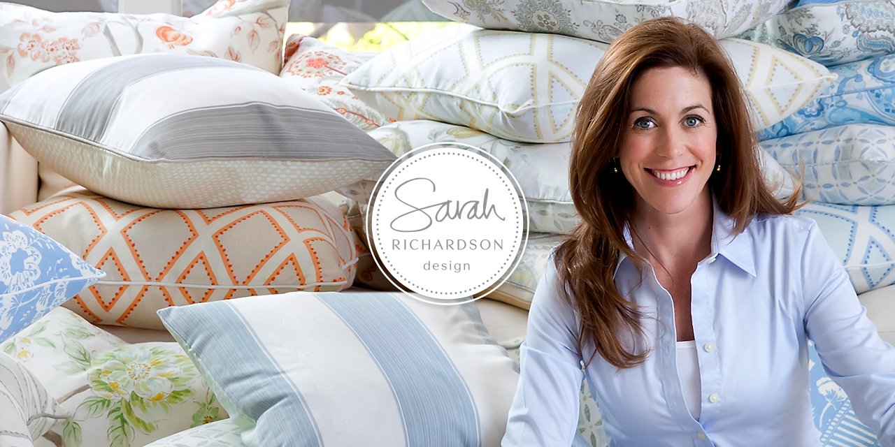 Sarah Richardson, Interior Designer sitting with her own line of Kravet Fabric