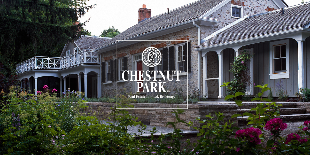 Beautiful stone house with Chestnut Park Logo overlayed on top of it
