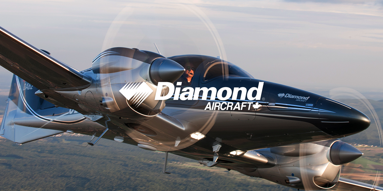 Diamond Aircrafts DA62 Airplane flying over fields