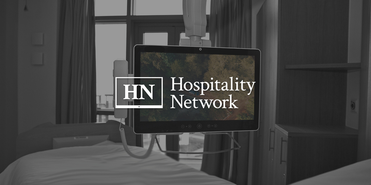 Hopsital bed with televison infront of viewer with Hopspitality Netowkr Logo overlayed on top of it